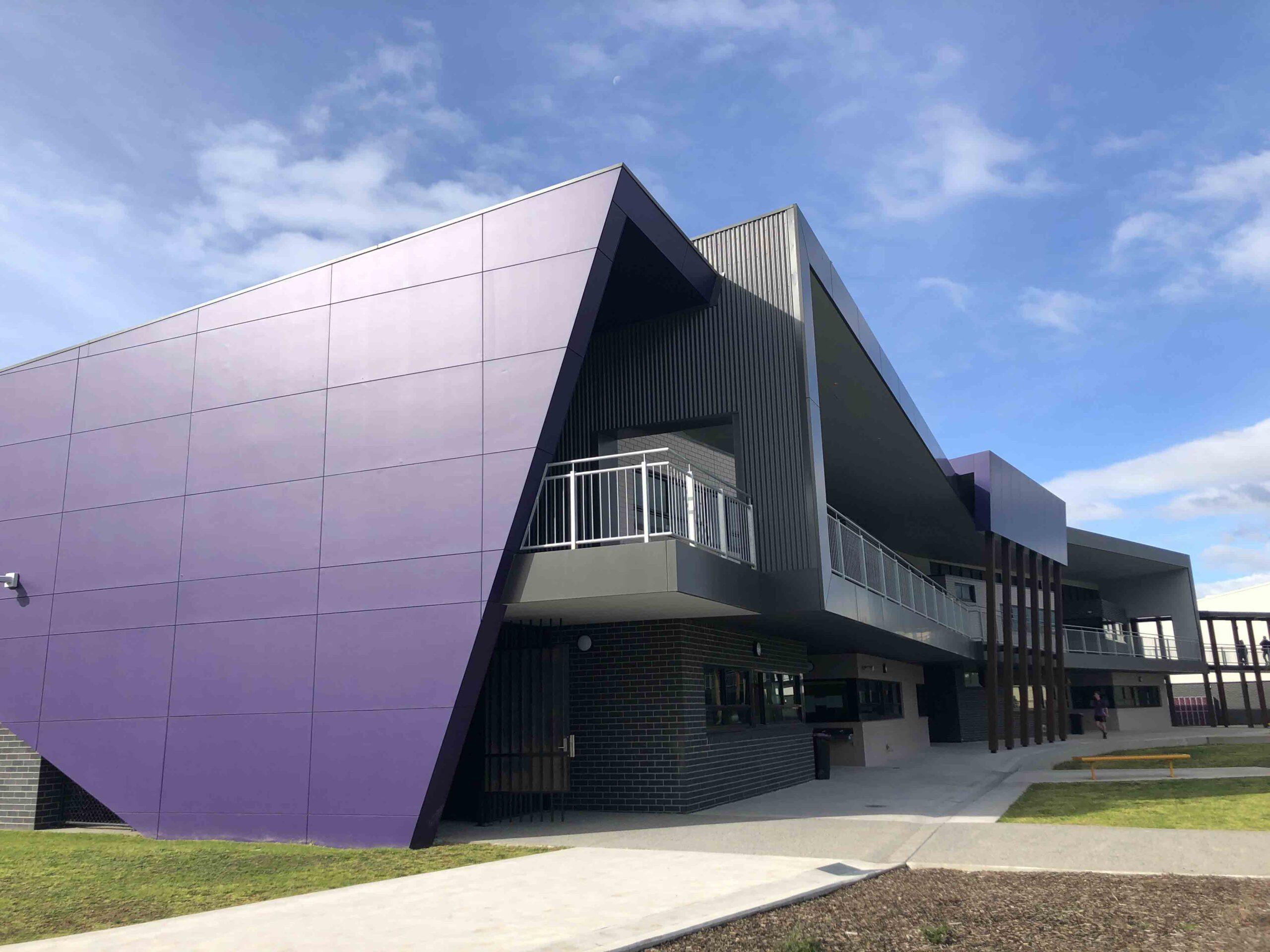 A picture of the Senior School Building showcasing it's purple facade.
